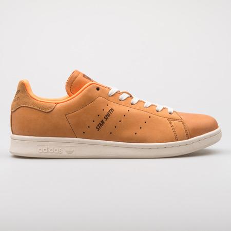 VIENNA, AUSTRIA - AUGUST 7, 2017: Adidas Stan Smith orange sneaker on white background. Editorial