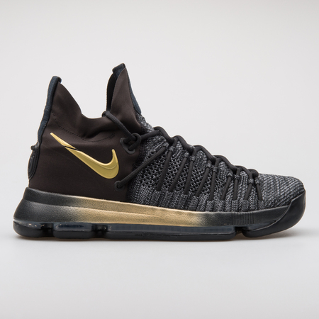VIENNA, AUSTRIA - AUGUST 7, 2017: Nike Zoom KD9 Elite black and gold sneaker on white background. Editorial