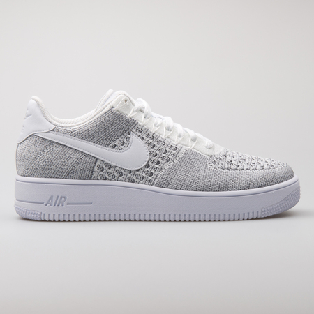 VIENNA, AUSTRIA - AUGUST 7, 2017: Nike Air Force 1 Ultra Flyknit Low grey sneaker on white background.