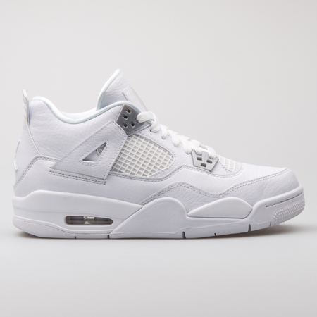 VIENNA, AUSTRIA - AUGUST 7, 2017: Nike Air Jordan 4 Retro BG white sneaker on white background.