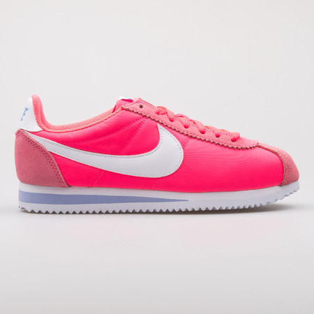 VIENNA, AUSTRIA - AUGUST 7, 2017: Nike Classic Cortez Nylon pink sneaker on white background.