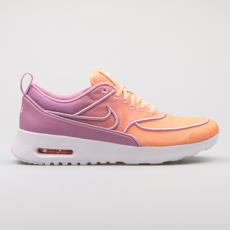 VIENNA, AUSTRIA - AUGUST 7, 2017: Nike Air Max Thea Ultra SI purple and orange sneaker on white background.