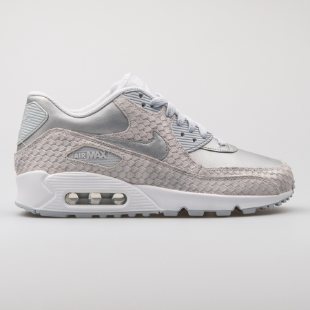 VIENNA, AUSTRIA - AUGUST 7, 2017: Nike Air Max 90 Premium beige and silver sneaker on white background.