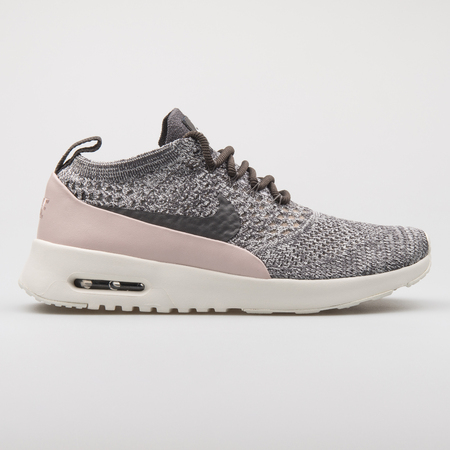 VIENNA, AUSTRIA - AUGUST 7, 2017: Nike Air Max Thea Ultra Flyknit grey and pink sneaker on white background. Editorial