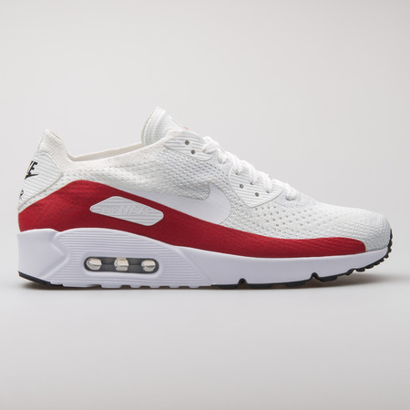 VIENNA, AUSTRIA - AUGUST 7, 2017: Nike Air Max 90 Ultra 2.0 Flyknit white and red sneaker on white background.