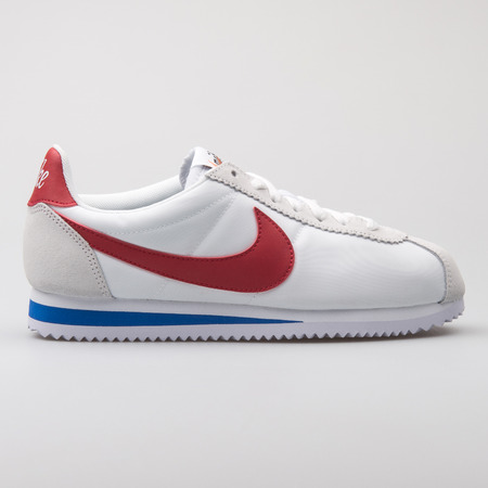 VIENNA, AUSTRIA - AUGUST 7, 2017: Nike Classic Cortez Nylon Premium white, red and blue sneaker isolated on white background.