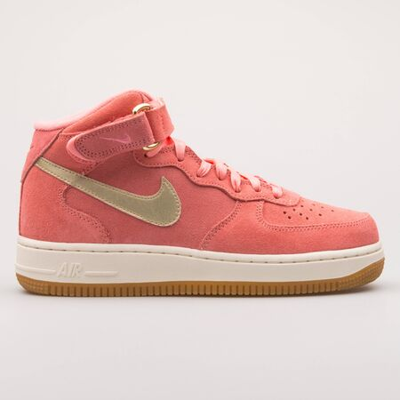 VIENNA, AUSTRIA - AUGUST 23, 2017: Nike Air Force 1 07 Mid Seasonal melon and gold sneaker on white background.