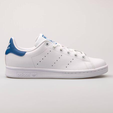 VIENNA, AUSTRIA - AUGUST 23, 2017: Adidas Stan Smith white and blue sneaker on white background.