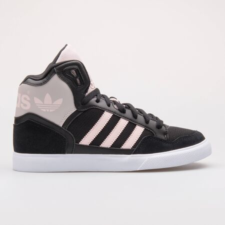 VIENNA, AUSTRIA - AUGUST 28, 2017: Adidas Extaball black and pink sneaker on white background.