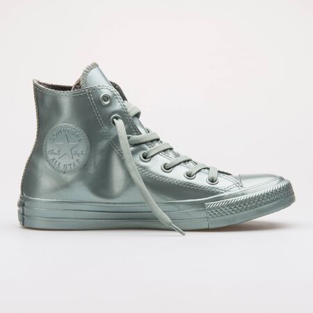 VIENNA, AUSTRIA - AUGUST 28, 2017: Converse Chuck Taylor All Star Metallic Rubber High green sneaker on white background.