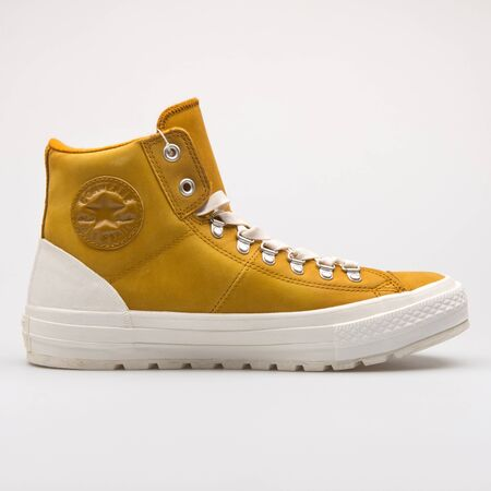 VIENNA, AUSTRIA - AUGUST 28, 2017: Converse Chuck Taylor All Star Street Hiker High yellow sneaker on white background.
