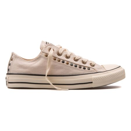 VIENNA, AUSTRIA - AUGUST 10, 2017: Converse Chuck Taylor All Star Eyebrow Cut Out OX parchment white sneaker on white background.