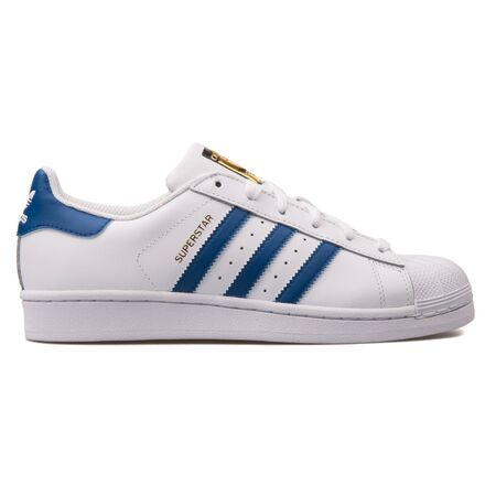 VIENNA, AUSTRIA - AUGUST 10, 2017: Adidas Superstar Foundation white and blue sneaker on white background. Editorial