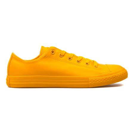VIENNA, AUSTRIA - AUGUST 10, 2017: Converse Chuck Taylor All Star Rubber OX Honey yellow sneaker on white background.