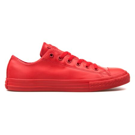 VIENNA, AUSTRIA - AUGUST 10, 2017: Converse Chuck Taylor All Star Rubber OX red sneaker on white background.