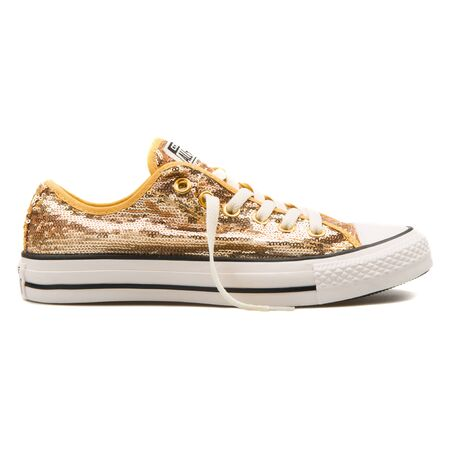 VIENNA, AUSTRIA - AUGUST 25, 2017: Converse Chuck Taylor Sequin OX gold and white sneaker on white background.