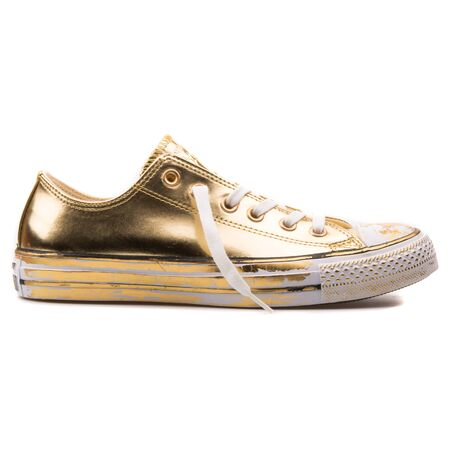 VIENNA, AUSTRIA - AUGUST 25, 2017: Converse Chuck Taylor OX gold and white sneaker on white background.