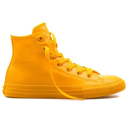 VIENNA, AUSTRIA - AUGUST 25, 2017: Converse Chuck Taylor High Wild Honey yellow sneaker on white background. 報道画像