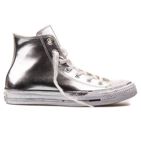 VIENNA, AUSTRIA - AUGUST 25, 2017: Converse Chuck Taylor Chrome High silver and white sneaker on white background. 報道画像