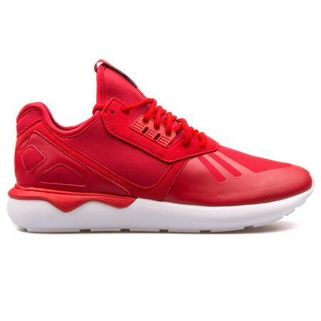 VIENNA, AUSTRIA - AUGUST 25, 2017: Adidas Tubular Runner red and white sneaker on white background.