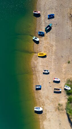 Aerial view of boats on the beach. Lokve lake in Croatia.