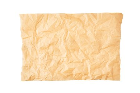 Crumpled piece of parchment or baking paper isolated on white background. Top view. Copy space for text and design element.