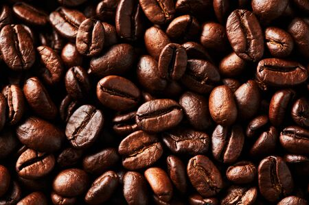 Roasted coffee beans background. For design and texture Close up.