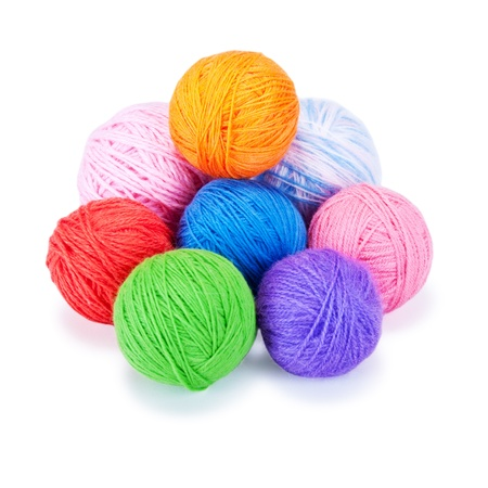 yarn: Several multi-colored woolen balls on a white background Stock Photo