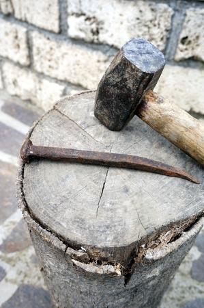 rusty nail: Working tools - Big hammer with a big old rusty nail