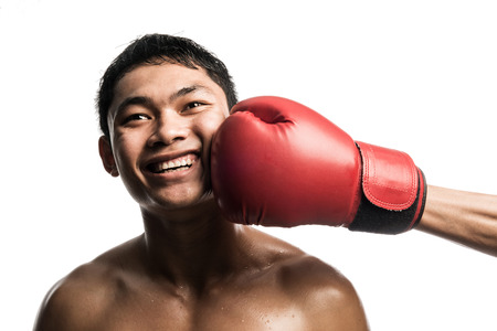 punched: Boxing punch on the man face isolated on white Stock Photo