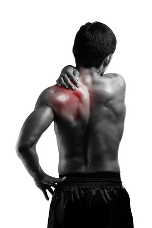Young man with back pain, isolated on white Banco de Imagens