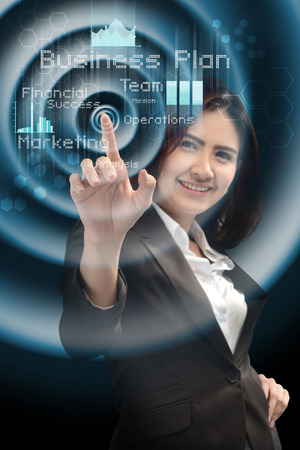 smiling businesswoman working with virtual screen photo