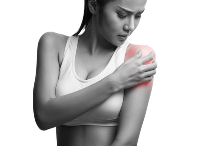 reddening: young muscular woman with shoulder pain,isolated on white background with clipping path Stock Photo