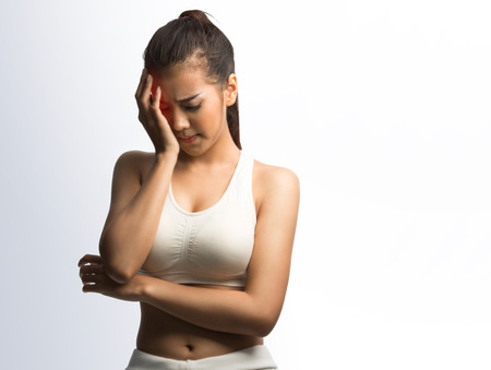 sexy asian woman: Young woman with headache holding her hand to the head ,on white background with clipping path