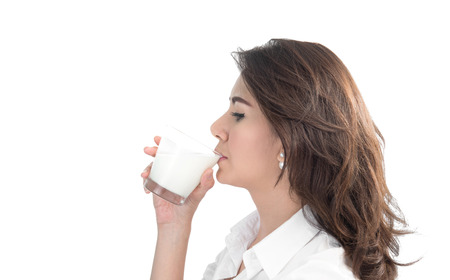 woman drinking milk: young woman drinking milk Stock Photo