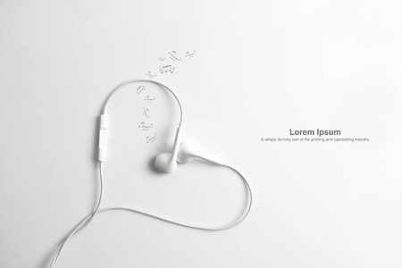 Earphone and cord in shape of heart. on white background.