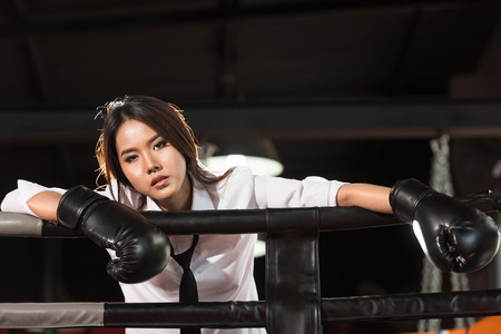 asian businesswoman: Loser businesswoman on boxing ring. Winner and business success concept Stock Photo