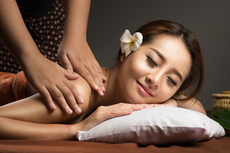 body spa: Asian woman having massage and spa salon Beauty treatment concept. She is very relaxed Stock Photo