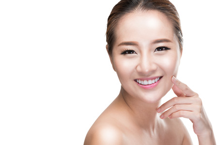 Beautiful woman cares for the skin face - posing at studio isolated on white with clipping path,asian Beauty. Imagens