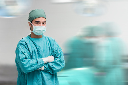Surgeon at operating room in the hospital,looking at camera,motion blur background.