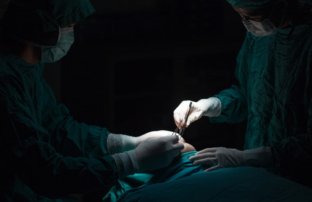 Plastic surgery wrinkle reduction , asian man during surgery using a scalpel , Plastic surgery.
