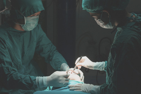 surgery: Plastic surgery wrinkle reduction , asian man during surgery using a scalpel , Plastic surgery.