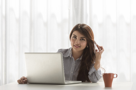 enjoy space: Beautiful young asian woman using laptop at home Stock Photo