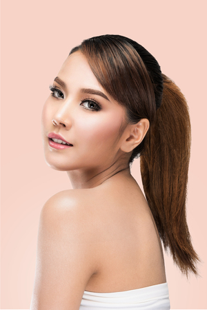 sexy nude women: Beauty Asian Woman face Portrait. Beautiful Spa model Girl with Perfect Fresh Clean Skin. looking at camera. Youth and Skin Care Concept. on pink background with clipping path