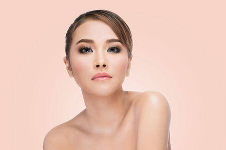 beautiful women: Beauty Asian Woman face Portrait. Beautiful Spa model Girl with Perfect Fresh Clean Skin. looking at camera and smiling. Youth and Skin Care Concept. on pink background with clipping path