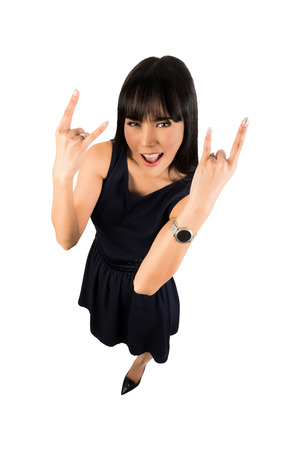 heavy metal: Woman showing the rock sign to the camera, that is above in high angle view. Wide angle.isolated on white with clipping path