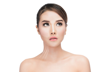 Face lift anti-aging treatment, portraitAsian woman with graphic lines showing facial lifting effect on skin,antiaging concept.