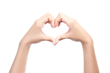 handsign: Female hands in the form of heart isolated on white background