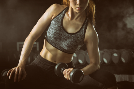 Professional sport fitness woman, Asian woman lifting weight in gym.