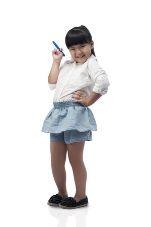 hispanic girl: happy little girl drawing or writing something with a pen,Magic Pen childhood, preschool education, creativity, learning and people concept isolated on white